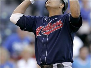 The Indians' Victor Martinez crosses home plate after homering in the second inning. Martinez had three hits last night.