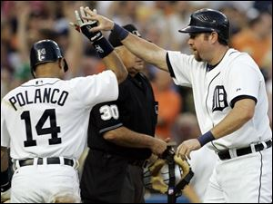 Sean Casey, right, is congratulated by Placido Polanco after scoring on Curtis Granderson's double in the second inning.