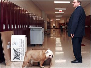 John Foley, superintendent of Toledo Public Schools, tours the new Byrnedale Middle School alongside Gracie, the school mascot. Educators, students, and parents seemed excited about the new schools.
