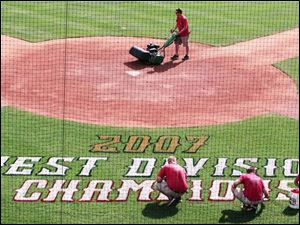 The grounds crew prepares Fifth Third Field for the Mud Hens  bid for a third straight Governors  Cup. The Hens clinched a spot in the International League playoffs with a win Sunday at Indianapolis and will play either Richmond or Durham in the fi rst round. As West Division champs, the Hens will host games three through five beginning Sept. 7.