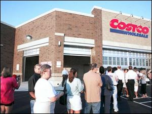 Shoppers wait in anticipation of the bargains inside on Costco s first day at Westgate Village Shopping Center.