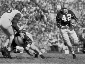 Dick Kazmaier carries the ball for Princeton in 1951.