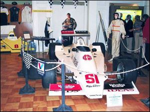 An Indy race car sporting Monroe shocks is among the items on display at the Monroe County Historical Museum.