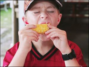 NBRE corn30p  Daniel Lambert, 11, of Lyons, at the festival. The Swanton Corn Festival offers rides, food, music and a car show in Memorial Park in Swanton, Ohio on August 25, 2007.  The Blade/Jetta Fraser.