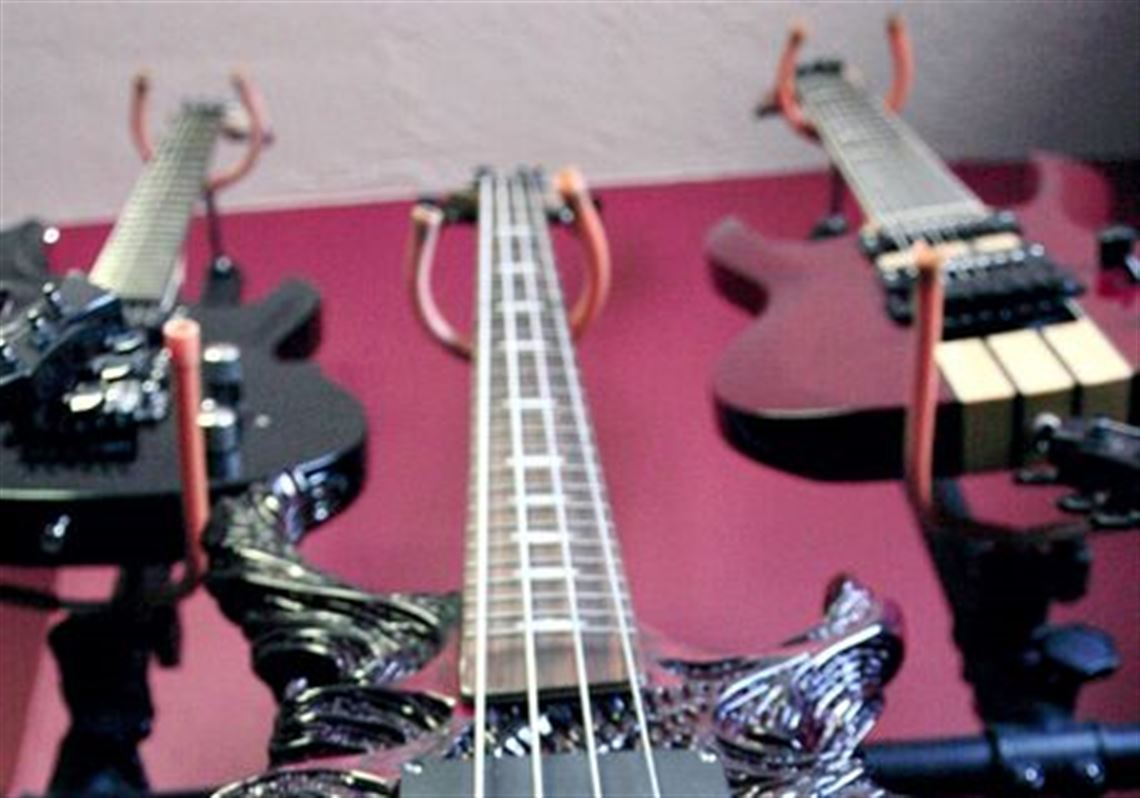 Sounds Of Death On 8 Strings California Guitar Maker Serves Heavy