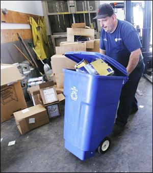 Ron Kubicki sorts recyclables at the University of Toledo,