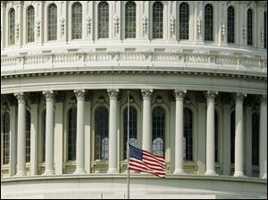A flag at the U.S. Capitol flies at half-staff in honor of Rep. Paul Gillmor and former Rep. Jennifer Dunn. Both died Wednesday.