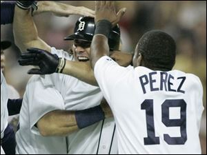 Teammates congratulate Magglio Ordonez after his single in the bottom of the ninth inning scored Curtis Granderson and Placido Polanco to give the Tigers a 5-4 comeback victory.