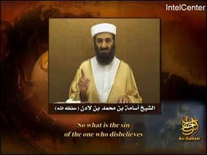 This frame grab taken from an undated video message carrying the logo of al-Qaida's production house as-Sahab and provided Tuesday, Sept. 11, 2007 by IntelCenter, a U.S. government contractor monitoring al-Qaida messaging, shows Osama bin Laden raising his finger while speaking.