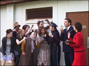 Rehearsing for the Croswell Opera House production of Urinetown are, in front from left: Jamie Buechele, Jessica Randall,