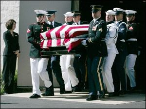 U.S. Rep. Paul Gillmor s coffin is carried by an honor guard after his funeral in Tiffin.