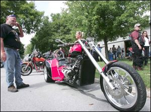 John Allgood of woodville checks out the 2007 V8 Vhopper owned by Kim Flegle (behind the bike).