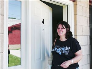 Cheryl Lorton closes the door after touring what will be her new home at Safe Haven on 21st Street downtown.