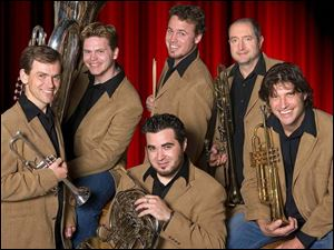 The Dallas Brass comprises, clockwise from left, D.J. Barraclough, Nat McIntosh, Jeff Handel, Michael Levine, Brian Neal, and Chris Castellanos.
