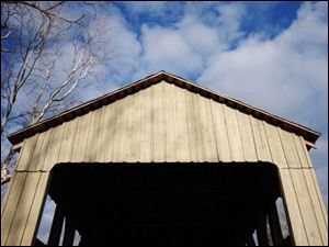 Black Covered Bridge runs 206 feet over Four Mile Creek. This 1868 design on Corso Road outside Oxford, Ohio, in Butler County is closed to motor