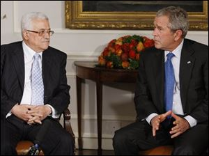 President Bush, right, makes a statement to reporters as Palestinian President Mahmoud Abbas, left, looks on during their meeting on the sidelines of the United Nations General Assembly in New York Monday, Sept. 24, 2007.
