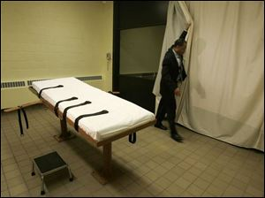 A state employee shows the death chamber at the Southern Ohio Correctional Facility in Lucasville in 2005. The report said Ohio is 3.8 times more likely to impose the death sentence on the killer of a white victim than on a killer of a black person.