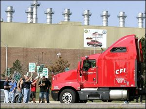 Autoworkers block a truck at a General Motors facility in Pontiac, Mich. About 73,000 GM workers went on strike nationwide.