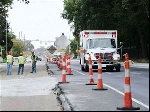 Cherry Street will be open through the Central intersection but lane closings will continue as the $6 million reconstruction project proceeds through its final stages.