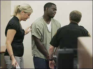 Ohio State quarterback Antonio Henton appears in Franklin County Municipal Court with his attorney, Tasha Ruth.