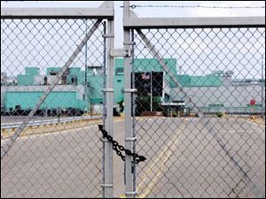 The gate is locked at the entrance to the General Motors Corp.'s Powertrain Plant on Alexis Road in Toledo.