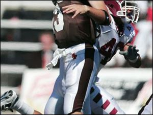 BGSU quarterback Tyler Sheehan gets hit by a Temple defender on this play, but in three games he has completed 96 of 148 passes for 1,034 yards and seven touchdowns.