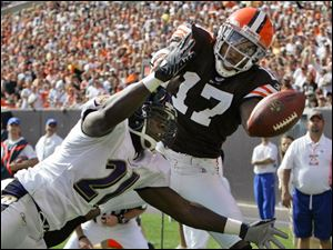 Ravens cornerback Chris McAlister, left, breaks up a pass in the end zone intended for Browns receiver Braylon Edwards.