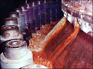 Red, rusty deposits on this nuclear reactor vessel flange were caused by boric acid. Plant officials learned that the acid had burned through everything but a stainless steel liner.