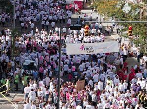 Runners and walkers fill the streets in downtown Toledo during the Race for the Cure.