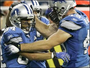 Detroit wide receiver Shaun McDonald, left, celebrates catch ing a four-yard touchdown pass with teammate Sean McHugh.