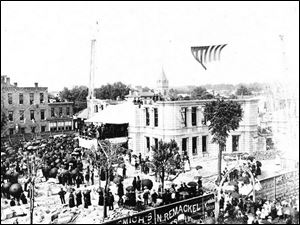 Crowds thronged the streets of downtown Tiffin for the laying of the cornerstone of the Seneca County Courthouse in June, 1884.