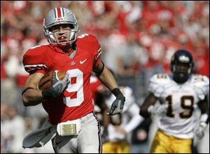 The Buckeyes' Brian Hartline finishes off a 90-yard punt return for a touchdown. The return broke a 57-year-old record.