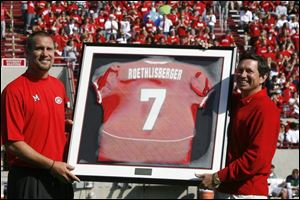 Steelers quarterback Ben Roethlisberger, left, is presented his Miami jersey by the university president David Hodge prior to yesterday's game with BGSU. Ben graduated from Findlay High.