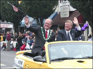 There also was a parade, featuring Mayor Craig Stough, at right, and a special guest seated beside him - Mayor Michael Harding of Woodstock, Ontario, Sylvania's Sister City. The mayors were grand marshals of the parade.