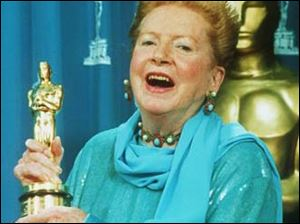 Deborah Kerr holds her Oscar, which was presented to her as an honorary award at the Academy Awards in Los Angeles, March 21, 1994.
