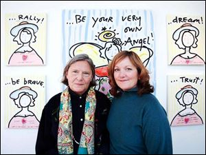 Artist and activist Nancy Swan Drew, left, poses in front of her artwork with Kathie Kolodgy during the Be Your Own Angel Soiree at the MMK Gallery.