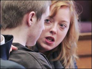 Robert Jobe and his attorney, Ann Baronas, confer during a hearing in Common Pleas Court. The defense team has said all along that young Jobe can- not get a fair trial in Lucas County. Other arguments yesterday included a debate on whether the teen's past encounters with police can be admitted into evidence. Jury selection is set to begin Oct. 29.