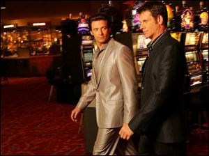 Hugh Jackman, left, plays the evil Nicky Fontana, and Lloyd Owen is Ripley Holden in the quirky Viva Laughlin.