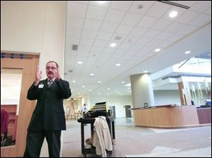 Gary Gordon, president of Toledo Hospital, stands in the lobby of the new building, construction of which began in 2005.