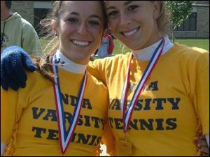 Notre Dame's Tara Majdalani, left, and Meredith Morse wear district champions medals. They were third at state in 2005 and and lost in the quarterfinals last season.