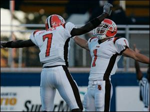 Bowling Green's Freddie Barnes, left, celebrates the touchdown catch of Corey Partridge, right, against Kent State in the fourth quarter yesterday on a 28-yard pass from Tyler Sheehan.