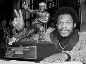 Archie Griffin emphasizes he has won two Heismans in this photo of the Buckeye running back after the 1975 season.