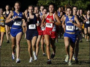 Central's Emma Kertesz (695) came away with a victory in one of the Division I district cross country meets yesterday.