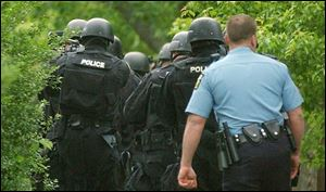 Toledo SWAT teams respond to standoffs and assist in executing drug search warrants.