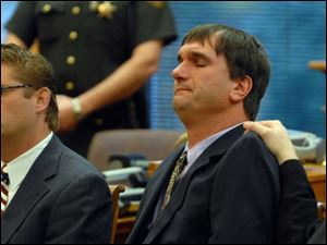 Scott Speer, right, and his attorney, J. Anthony Rich, react to the verdict in Port Cliton yesterday.