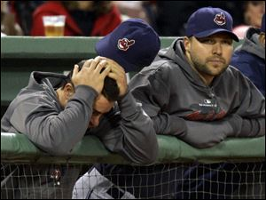 Indians David Dellucci, left, and Jake Westbrook have a tough time watching the developments in Game 6 of the ALCS against the Red Sox in Fenway Park - part of The Collapse.