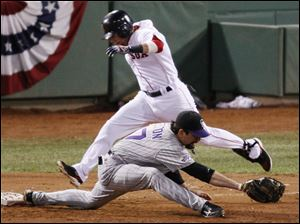 Boston s Dustin Pedroia is out at first as Colorado s Todd Helton