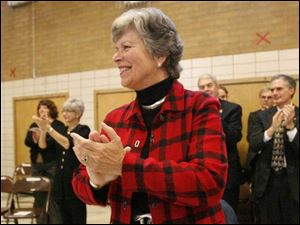 Frances Strickland applauds enthusiastically during a performance by children in the Bowling Green State University Kindergarten Project.
