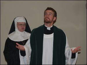 Sister Aloysius (Kimberly Yost) is suspicious of the behavior of Father Brenden Flynn (Kurt Kutchenriter) in Doubt, A Parable.