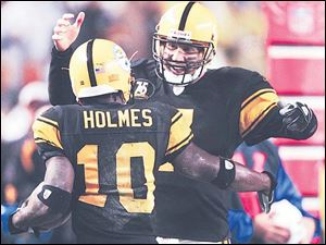 Pittsburgh s Ben Roethlisberger greets Santonio Holmes after Holmes pulled in one of Roethlisberger s five first-half touchdown passes. The Steelers improved to 6-2 with the victory.
